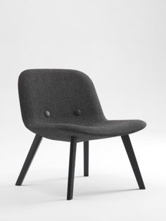 Erik Jorgensen Eyes Lounge Chair. The lavish and comfortable EJ Eyes series now includes a lounge chair. The visual character and comfort is repeated in this new wider and lower version. The Eyes Lounge chair frame is available in oak, black stained oak, mat chromed or lacquered steel.