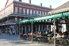 Morning Coffee-Cafe Du Monde-800 Decatur St., New Orleans- the original French Market coffee stand serving cafe au lait and beignets. A New Orleans landmark,· Open 24 hours