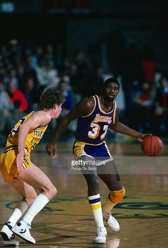 b59cfc0d9 Earvin Magic Johnson  32 of the Los Angeles Lakers dribbles the ball  guarded by Pace