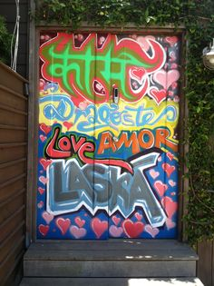 JOHN MACK Construction and Design: Eclectic Venice bungalow, Graffiti art at side gate