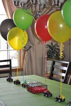 Table center piece. Cars, monster trucks, fourwheelers, attached to balloons.