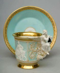 """ganymedesrocks: """" Impressive and rare porcelain cup and saucer. """" This Impressive & rare porcelain cup & saucer, its sides adorned with mythological figures on a turquoise ground; because of its elaborate handle decorated with an. Coffee Cups, Tea Cups, Teapots And Cups, My Cup Of Tea, Tea Service, Tea Cup Saucer, Tea Time, Vases, Tea Party"""