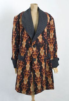 "Gentleman's smoking jacket, 1870s-1880s    In the 1850s, the Gentlemen's Magazine of London described the smoking jacket as a ""kind of short robe de chambre, of velvet, cashmere, plush, merino or printed flannel, lined with bright colors, ornamented with brandenbourgs, olives or large buttons."""