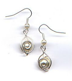 Simple, elegant pearl earrings.  Very Doable. Make a pendant to match.  Round crystals would work too!