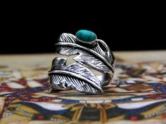 Absolutely beautiful silver feather ring with turquoise. Hand crafted with high quality jewelry brass with three layers of silver plating and turquoise. Collected by us while traveling through the desert villages of Northwest India.  Turquoise represents the spiritual growth and