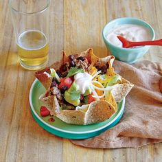Beef and Bean Taco Salad | To help keep the tortillas in the shape of a bowl, keep the ramekins on the pan when you flip the tortillas over, and use them as supports to help prop up the tortilla bowls.