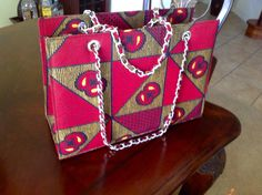Handbag from Nigeria with traditional Ankara print. Have or give something different.  https://www.pinterest.com/janethokoronkwo/crocodile-ostrich-and-ankara-handbags-and-purses/