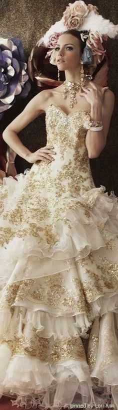 Stella de Libero. A dress for a ball! ruffles and lace! But someone take that thing off her head!
