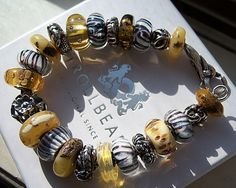 WOLVES CATCHING SOME RAYS! A great bracelet with many Grey Wolves-a whole pack of them!  http://www.trollbeadsgallery.com/grey-wolf/