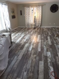 """Was going to go for the safe look and choose a distressed grey color, but saw the barn wood option and thought we'd take a chance."" [Bull Barn Oak] Really amazing Future House, My House, House Goals, My New Room, Lofts, Barn Wood, Rustic Wood Floors, Distressed Wood Floors, Weathered Wood"
