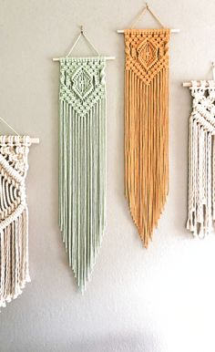 Mint & Mustard Long Macrame Wall Hanging This mint and mustard color macrame wall hanging combo brings bright color and energy to your space. Looking to remodel or redecorate? Add this easy diy piece to your home decor macrame wall hanging easy Macrame Wall Hanging Patterns, Crochet Wall Hangings, Boho Wall Hanging, Macrame Patterns, Macrame Wall Hanger, Macrame Design, Macrame Art, Macrame Projects, Macrame Knots