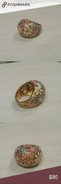 Coach Flower Blossom Ring This pastel rainbow colored flower ring features 15 faux crystal detailing and the signature Coach logo inscribed on the inside metal. Fits a ring size Like new. Coach Jewelry, Jewelry Rings, Ring Designs, Flower Designs, Flower Blossom, Gold Interior, All Sale, Cut And Style, Clip On Earrings