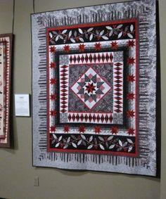 A Touch of Red Round Robin quilt, chosen to hang in an exhibit at the National Quilt Museum in Paducah, KY