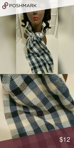 New Blue plaid scarf New Blue plaid scarf   100% acrylic  Blue black white  Aprox. 48in. Long 11.75in. Wide Accessories Scarves