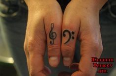 The bass clef tattoo. Yes.