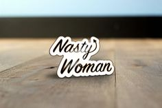 This is how Donald Trump speaks about women, and its not ok. Dont let anyone forget. I designed this pin out of pure disgust and a desire to channel that into something positive. Hopefully if we see each other wearing these we will know the entire country isnt against us. Sorry to sound so depressed right now. Please note- this is a preorder, my next batch is shipping on the 18th. I sold out on Election Day, but we need these pins now more than ever! ✊   This is a white, black, and gold…
