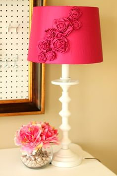 For a lamp that desperately needs a makeover. Steal this idea for inspiration: spray painted brass lamp, fabric hot glued to shade Room Decor For Teen Girls, Diy Luminaire, Fabric Rosette, Rosettes, Fabric Flowers, Ribbon Flower, Pink Fabric, Office Lamp, Lamp Makeover