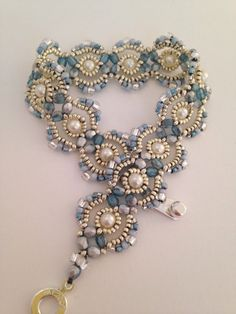 Sky blue and silver Lovely Lace hand beaded by BeadALittleDream