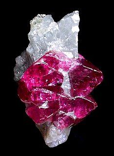 Pink spinel crystals with white clinohumite