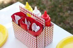 Re-purposed  6 pack drink holder for condiments - BBQ, camping, picnics....Or gifting st*rbucks bottles filled w/ different candy. cute idea