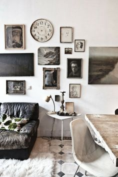 art wall, gray and white, tile floor, eames chair, old leather sofa.