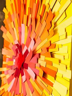 This easy paint chip sunburst project will add a pop of color to any room! See more DIY wall art projects: http://www.bhg.com/decorating/do-it-yourself/wall-art/wall-art-projects/?socsrc=bhg[in052613sunburst=21