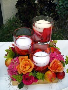 bright pink and orange arrangement with floating candles and fruit as centerpieces Candle Wedding Centerpieces, Floral Centerpieces, Wedding Decorations, Centrepieces, Centerpiece Ideas, Table Arrangements, Floral Arrangements, Flower Arrangement, Deco Floral