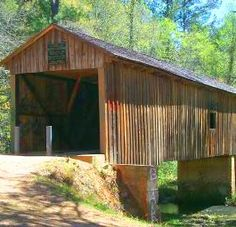 Coheelee Creek Covered Bridge in Georgia - Such great memories of jumping off the waterfall and tubing down the creek here!