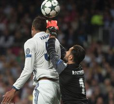 Sporting's Euro 2016 winning keeper Rui Patricio just about stretches far enough to take the ball off Raphael Varane's head