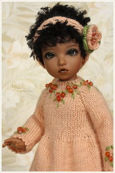 Maram Banu on Flickr shared this 2012 natural-light photo of her doll Gracie, Efreet sculpt in light brown skin color by Iplehouse.  Gracie wears a knitted dress of peach salmon color, with beading.  Canon EOS 450D #knitting #doll #dress #Iplehouse #bjd