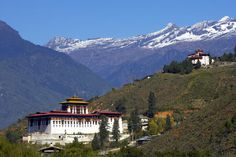 Bhutan, Lonely Planet #1 place to visit 2013?. Monastery situated in Paro Valley, with mountains in the background.