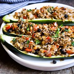 Zucchini boats with brown rice, green lentils, pine nuts and dried wild blueberries. Savory, sweet, spicy and sour with perfect texture. #vegan #glutenfree