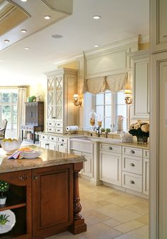 I love the dark wood on the island next to the creamy white cabinetry.