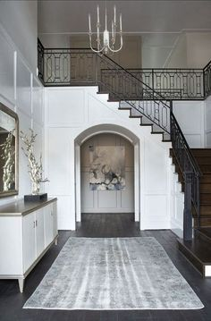 board and batten wall Linda McDougald Design - entrances/foyers - Sherwin Williams - Pure White - Eloquence Louis Philippe Silver Mirror, Lillian August Mercer Server, batten and b Iron Stair Railing, Staircase Railings, Iron Spindles, Iron Staircase, Staircases, Black Railing, Wood Railing, Staircase Ideas, Banisters