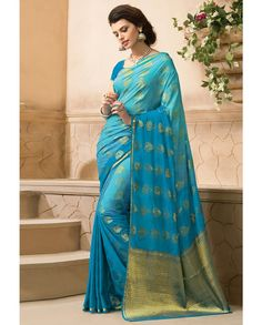 Blue sari with golden pallu   1. Blue crepe silk sari2. Comes with matching unstitched blouse material