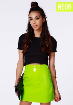 Showcase a little edge this season in this  #neon green #PVC #miniskirt. On trend and set to make a statement to any girl's wardrobe. Team with a #Missguided crop top, biker jacket and sky high heels.