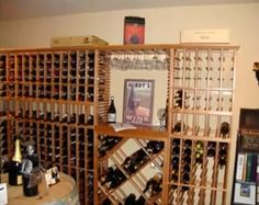 This beautiful wine cellar in San Diego has a tabletop area for serving and pouring along with a stemware wine rack that allows for wine glass storage and a lattice diamond storage bin for bulk storage. Coastal Custom Wine Cellars  26222 Paseo Toscana San Juan Capistrano, CA 92675‎  California Office: +1 (949) 355-4376