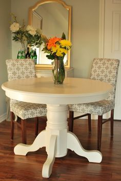 Painted Pedestal Table no matter how many times we see a piece of furniture painted white we still love the refreshing appeal it brings to the room. Painted Pedestal Tables, Pedestal Dining Table, Oak Table, Distressed Furniture, Painted Furniture, Muebles Shabby Chic, Dining Table Makeover, Dinning Room Tables, Dining Rooms