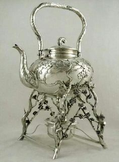BEAUTIFUL silver ornate tea server
