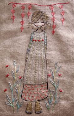 This whimsical girl standing under heart bunting in her garden is a hand embroidery pattern. There are instructions for two versions of the girl, the first with an embroidered dress and the second with an appliqued dress. The finished embroidery is about 21cm x 12.5cm (about 8 x 5) but you can enlarge the pattern or make it smaller by using a photocopier.  There are quite detailed instructions in the pattern and lots of photos. There are some beginner tutorials over on my blog at…