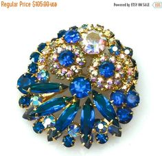 Juliana D&E Blue Rhinestone Brooch, Capri Blue, Aurora Borealis, Layered Brooch, 1960s by Vintageimagine on Etsy https://www.etsy.com/listing/242099315/juliana-de-blue-rhinestone-brooch-capri