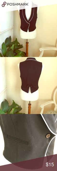 Forever 21 vest Forever 21 sleeveless black vest with white trim. Worn once. Looks new. 68% polyester, 28% rayon, and 4% spandex. Forever 21 Other