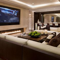 Tv, stone wall, and linear fireplace