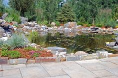 Beautiful pond design and installation recently completed! #landscaping #calgary #water #features #pond #ideas #backyard