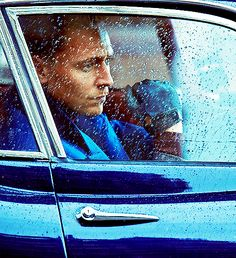 tom in the car in the rian