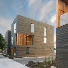 Weathered cedar and pine wrap these townhouses by Hacker Architects, which are geared towards residents who spend their time enjoying Oregon's outdoors.