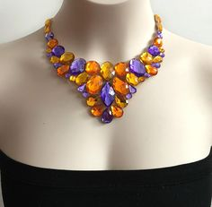 A personal favorite from my Etsy shop https://www.etsy.com/listing/226764980/purple-light-topaz-and-oragne-color