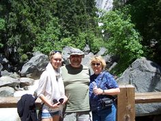 through the trees you can kinda see Vernal Falls (we hiked to the bridge).  L-R, Suri (their current, at the time, exchange student), Robb and Carol).  Yosemite Natn'l Park, CA  2012  i brought sandwiches and we had had a picnic earlier.