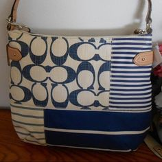 Coach Daisy Patchwork Convertible Hobo Patchwork fabric with genuine leather trim. Strap adjusts to allow use as shoulder or crossbody bag. Purse has been used only a few times and is in like-new condition. Still have original paper filler and plastic outer bag. Coach Bags Hobos