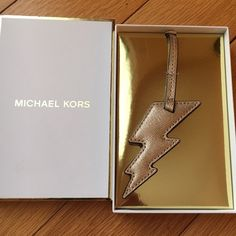 NEWMichael Kors Lightning Bolt Purse Charm NEWMichael Kors Ligtning Bolt purse fob. This is pale gold. With monogrammed Michael Kors on back of fob. Made of leather. no trade no PayPal no hold no lowball offers. ✅10% off bundles Michael Kors Accessories